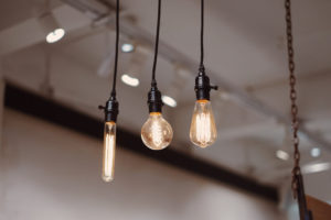 Three light bulbs from the ceiling